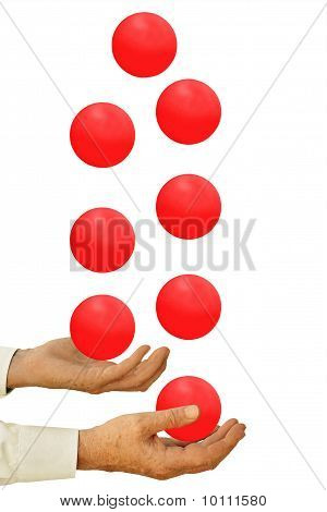 Businessman Juggling Many Balls In The Air