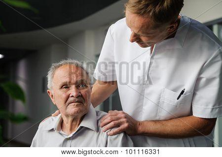 Healthcare Worker And Elderly Patient