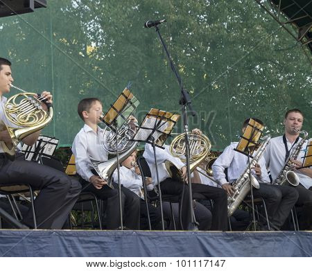 Mstera,Russia-August 8,2015:Orchestra musician plays on wind instrument on open scene in city Mstera