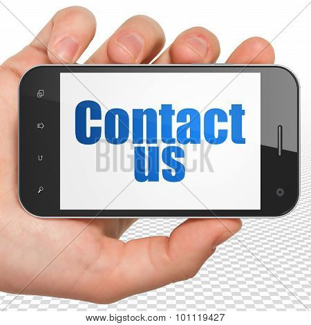 Advertising concept: Hand Holding Smartphone with Contact Us on display