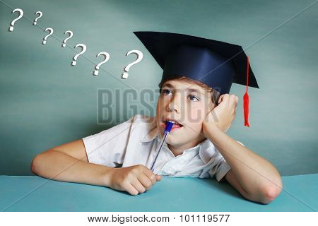 Boy In Graduation Cap Think About School Subject