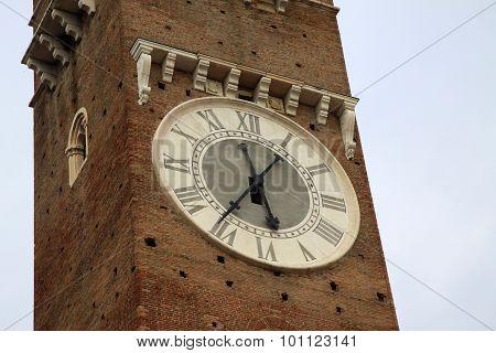 Clock On Lamberti Tower On Piazza Delle Erbe In Verona, Italy