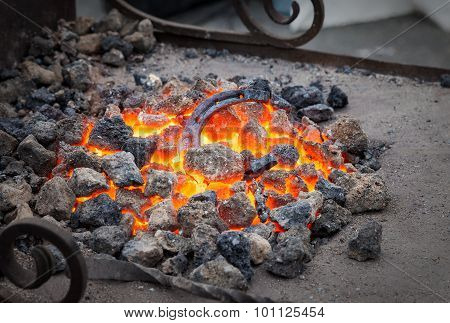 Blacksmithing, Metal Horseshoe Is Heated In The Forge On Coals