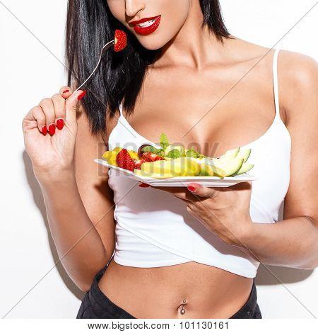 Sexy Woman Eating Fruit Salad