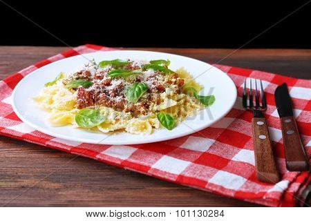 Pasta bolognese on wooden table, closeup