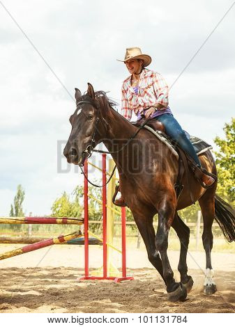 Western Cowgirl Woman Training Riding Horse. Sport