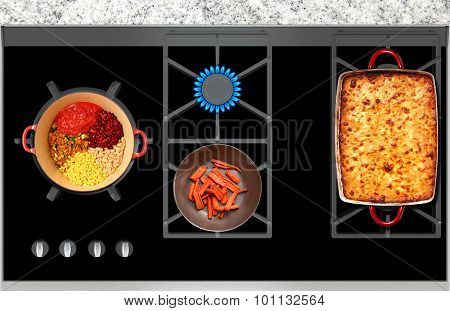 Cooking On A Gas Stove Casserole And Vegetables Top View