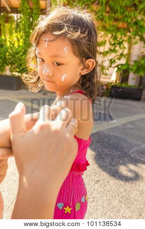 Sunblock Cream Being Applied on Child Body