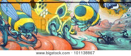 Street art bee on bike.