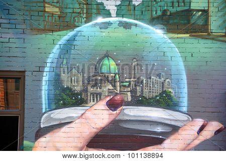 Street art snow globe