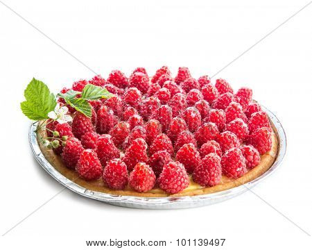 Tart with raspberries on a white background