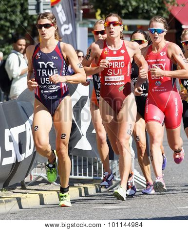 Triathlete Sarah True Running, Followed By Competitors