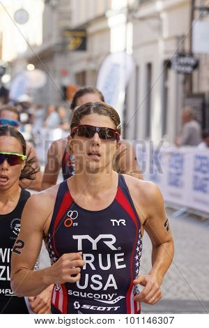 Close-up Of Triathlete Sarah True Running, Followed Competitors