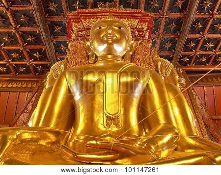 Big golden Buddha in ancient Buddhist temple - Wat Phumin,  Thailand.
