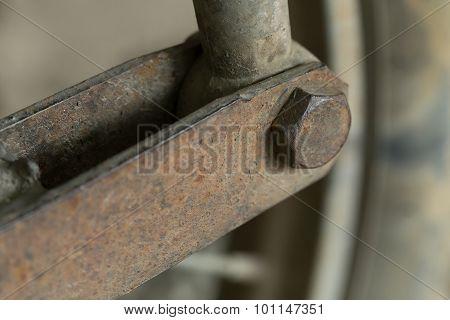 Rusty Screw Bolts On Metallic Panel
