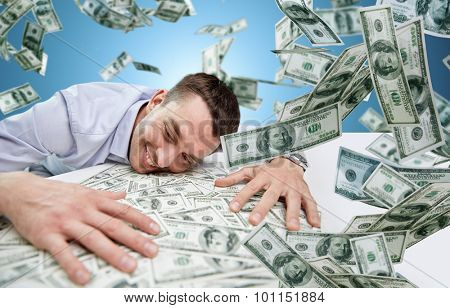 business, people, success and fortune concept - happy businessman with heap of dollar money over blue background