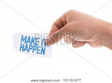 Piece of paper with the word Make It Happen isolated on white background