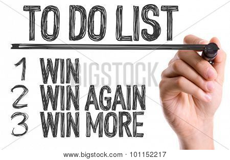 Hand with marker writing the word To Do List Win/Win Again/Win More