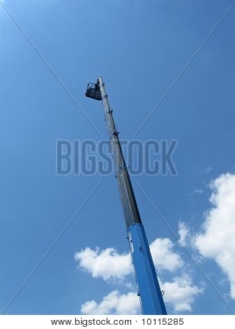 Industry Construction, High Long Industrial Crane Arm On Blue Sky