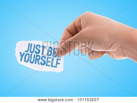 Piece of paper with the word Just be Yourself with blue background