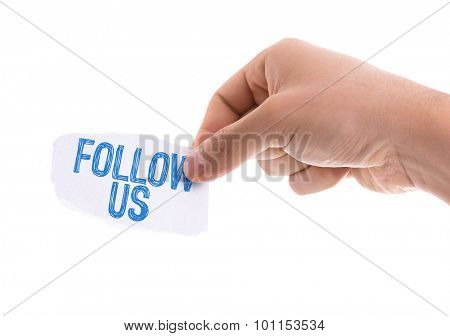 Piece of paper with the word Follow Us isolated on white background
