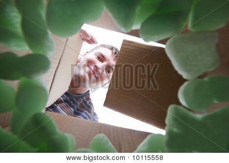 Man Opening Into Cardboard Box