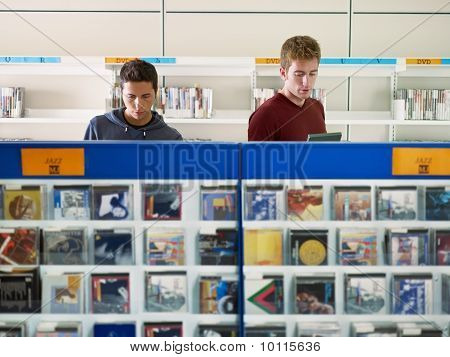 Two Guys Listening Music In Cd Store
