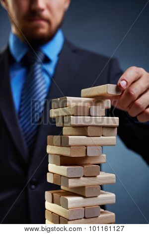 Business tower built by small wooden blocks