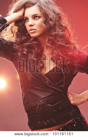 Glamorous girl in black leather jacket and lace tanktop
