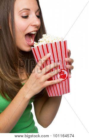 Pretty teenage girl eating popcorn