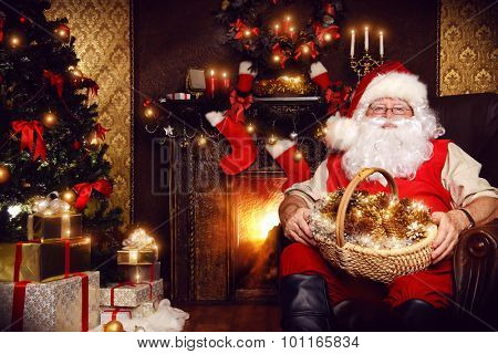 Santa Claus sitting at home with gifts, dressed in his home clothes. Christmas. Decoration.