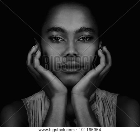 Beautiful Young Afro American Woman on Black