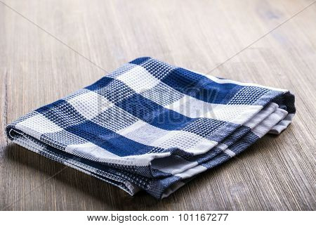 Canvas checkered cloth loosely laid on a wooden table