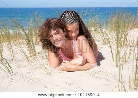 Young Girl And Her Mother Have A Good Time At The Seaside Resort