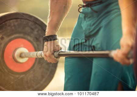 Closeup portrait of a man workout with barbell
