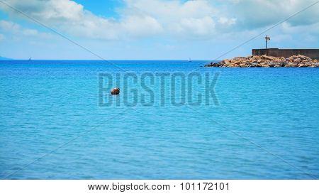 Red Buoy In Fertilia Harbor