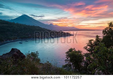 Sunset over the coast of northeastern part of the island of Bali, Indonesia