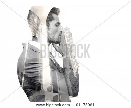 Double exposure image of a pensive man over cityscape