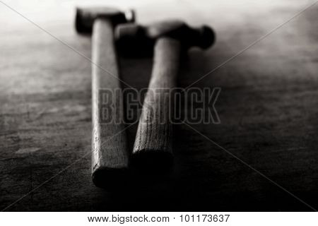 Old Hammers on a old wooden workdesk. Extremely shallow depth of field. Focus on foreground.