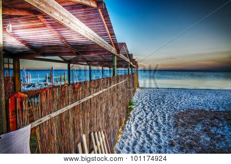 Wooden Cabin By The Sea At Sunset