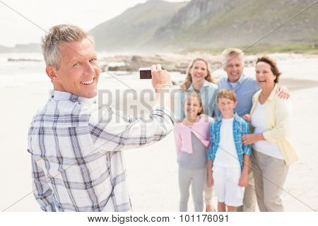 Multi generation family taking a picture at the beach