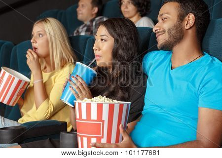 Young couple at the movie theatre