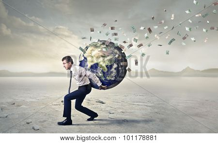 Businessman carrying the whole world