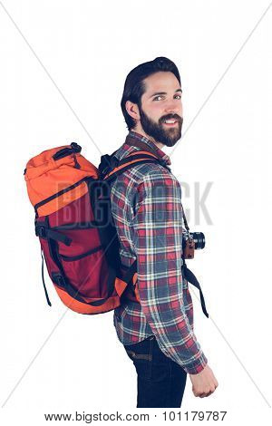 Portrait of hiker smiling against white background