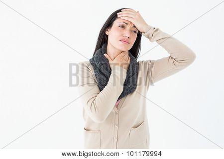 Sick brunette touching her throat and her head on white background