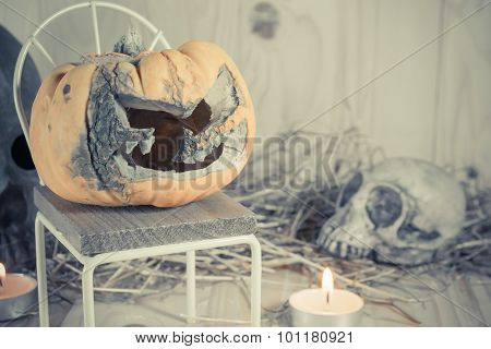Rotten Halloween Pumpkin With Candle Light On Wooden Background.