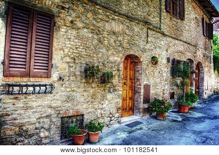Brick Wall And Flowers In San Gimignano