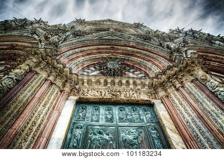 Santa Maria Assunta Cathedral In Siena Under A Dramatic Sky