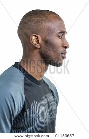 Profile view of confident athlete against white background