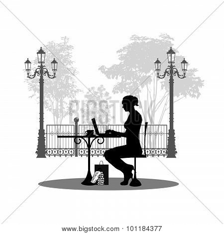 Silhouette of beautiful girl sitting in cafe.